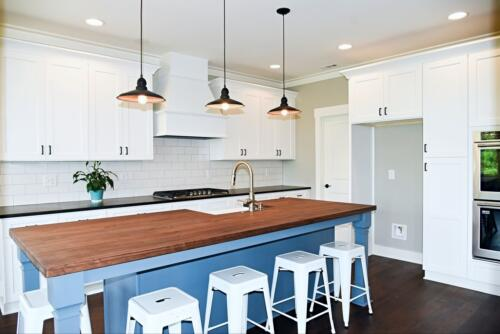 12 Brown Kitchen - New Home Construction with Elegant Custom Kitchens